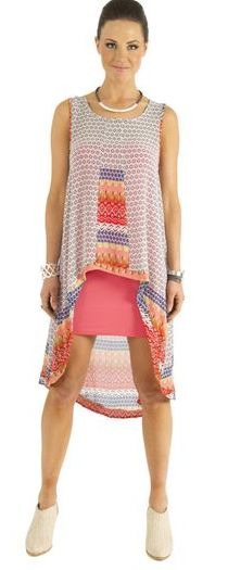 Sunset Mullet Tunic worn over coral singlet dress