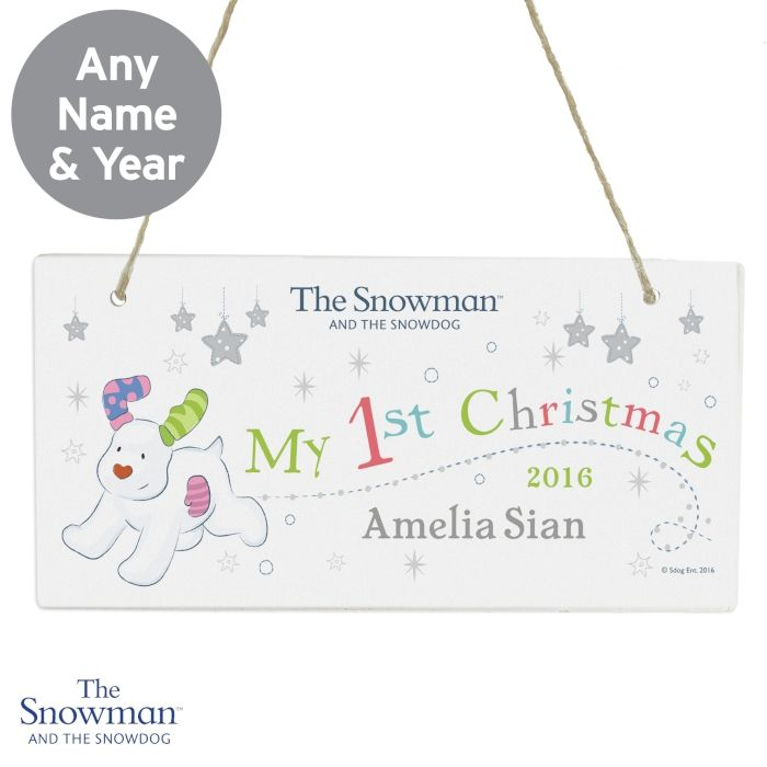 Personalised The Snowman and the Snowdog My 1st Christmas Wooden Sign Make their first Christmas extra special with this adorable The Snowman and the Snowdog 1st Christmas Wooden Sign.   This wooden sign can be personalised with a year up to 4 characters and a name up to 20 characters. #newbaby #1stchristmas #thesnowman #snowdog #plaques #personalised #overseashipping