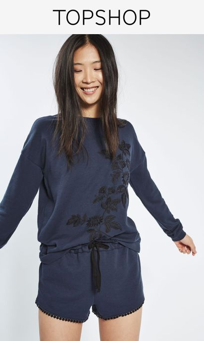 Upgrade your loungewear with this soft navy blue sweatshirt featuring black contrast floral embroidery. Pair with the matching shorts for ultimate stay-at-home comfort.