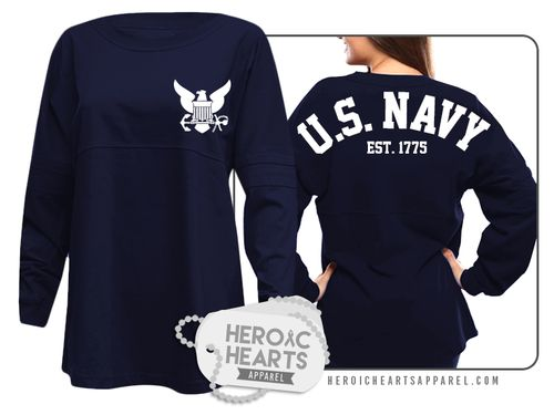 Featured here is our U.S. Navy Spirit Jersey!  This oversized jersey is perfect to show your support for the U.S. Navy and/or your sailor! This oversized fit pullover is constructed of 6.6 oz; 100% cotton jersey. Includes double athletic stripes on the sleeves.  Our spirit jerseys are garment-dyed for a vintage feel and a roomy fit.  These pullovers rull large, so we recommend a size down.  Customize this item even more by adding a custom name on it. Please make sure you double check our…