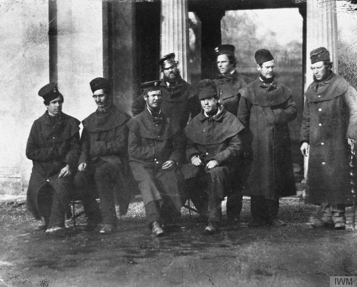 Group of Grenadier Guards convalescing from their Crimean War wounds at the Guards Barracks in London - including Private G. Ellesley, Private John Powell, Private G. Green, Private G.W. Busby, Private J. Simpson, William Moffat and Private G. Lester. © IWM (Q 71572)