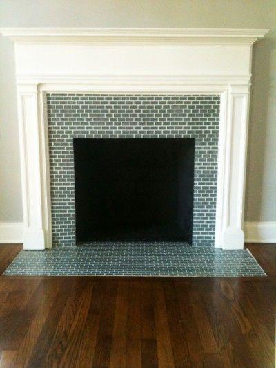 Mini glass subway tile surrounding the fireplace. Interesting idea! #fireplace #glass tile #interior #decor