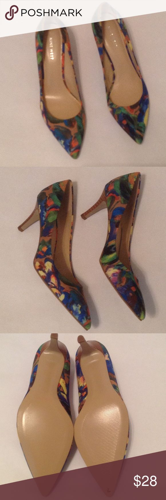 "🆕 Gorgeous floral Nine West heels Beautiful heels in shades of blue, yellow, coral. Fabric upper, man made sole. 3"" heel. Never worn. There is a ""7"" on the sole that was there when I bought it, don't know what it means. Just stunning! Size 8M. NWOT, no box. Nine West Shoes Heels"