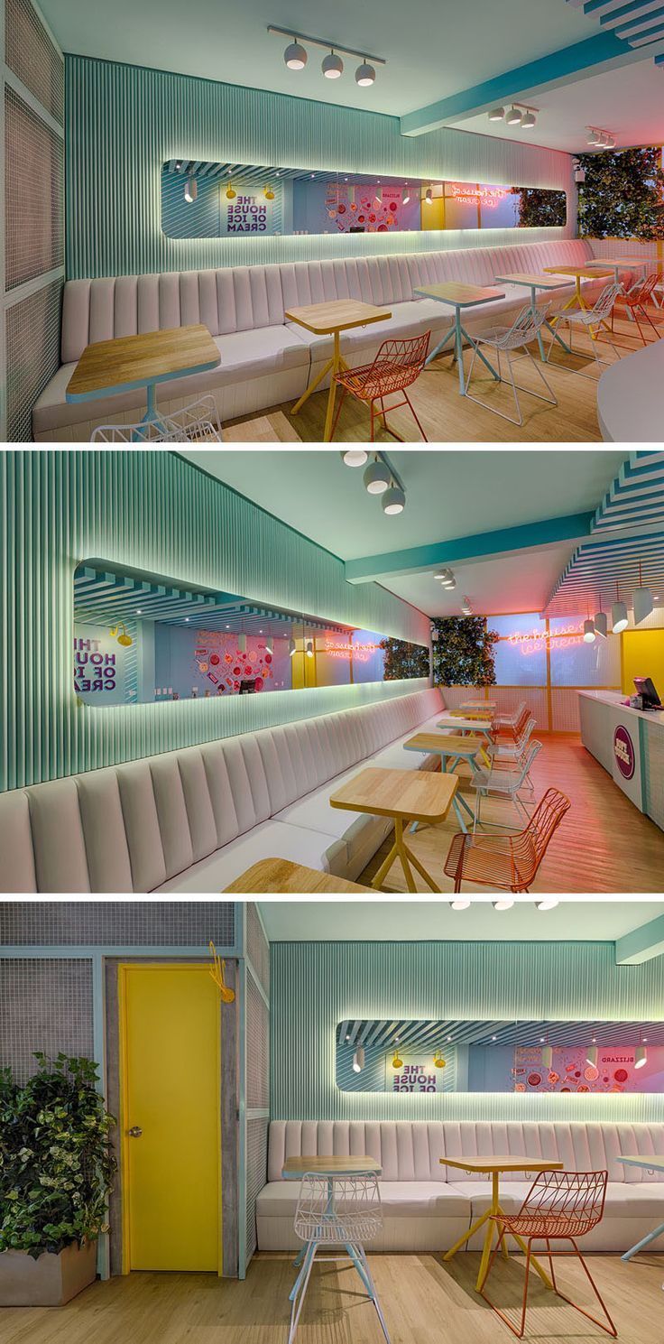 This modern ice cream store has a banquette of white seating with colorful tables and chairs that line the wall. Above the seating, there's a backlit long horizontal mirror that reflects the graphics and neon signage. #RetailDesign #IceCreamShop