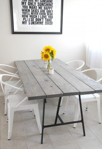 Table legs from IKEA for $10 plus some wood and you've got a table