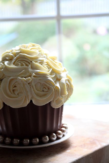 Giant cupcake in a hand moulded chocolate case.