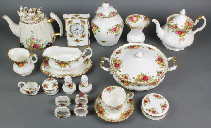 Lot 88, A Royal Albert Old Country Roses service comprising teapot and lid, 8 tea cups, 6 saucers, 2 tier cake stand, milk jug, sugar bowl, 6 dessert bowls, 6 large dessert bowls, 7 small plates, 7 medium plates, 6 dinner plates, 2 tureens and covers, 2 oval serving dishes, 4 odd dishes, 2 condiments, jar and cover, timepiece 8 napkin rings, baluster vase, a swan vase, ashtray, 3 lidded boxes, teapot with fancy lid, sauce boat and stand,  pickle fork, a lid etc, sold for £3360
