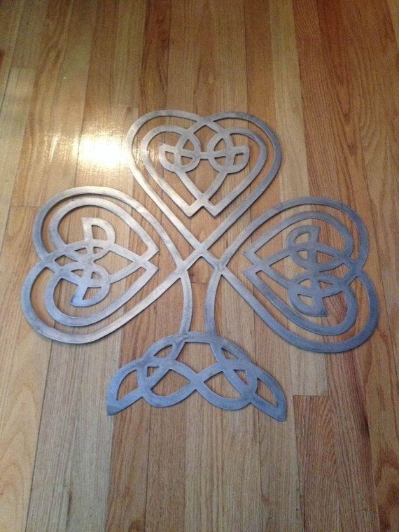 Metal Celtic knotted clover. This Irish inspired clover is styled like a Celtic knot.  Simple yet a great conversation piece. Measures 15 x
