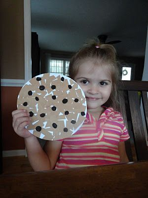 Make a cookie out of a paper plate, cut up brown construction paper into squares and black constructions paper into circles.