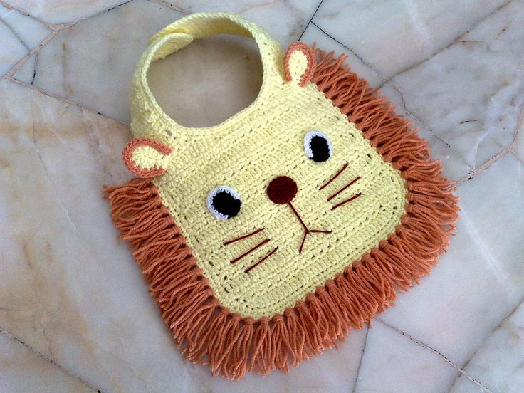 No pattern, but I think I can figure it out. It is too cute. Crocheted Lion Baby Bib | Flickr - Photo Sharing!