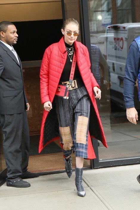 Gigi Hadid wearing Stuart Weitzman Clingy Booties in Black Nighttime, Tommy Hilfiger X Gigi Box Clutch, Vivienne Westwood Fall 2017 and Commando Ballet Body Mock Neck Bodysuit
