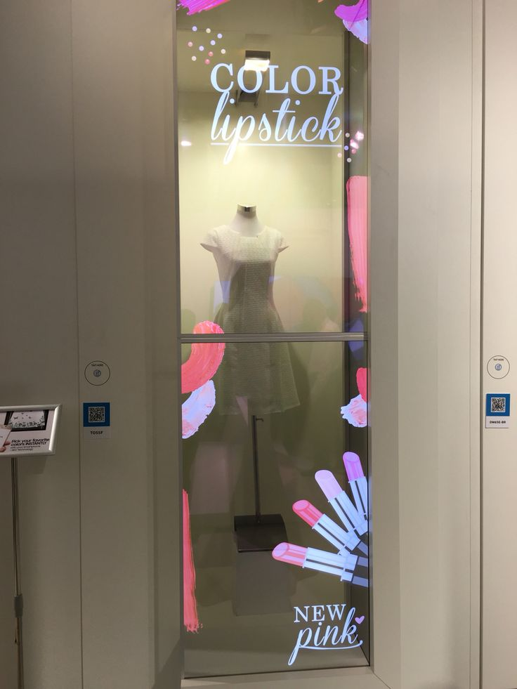 Interactive OLED display in a clothing store mockup.