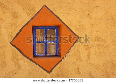Decorated mud wall of a traditional South African Basuthu hut by EcoPrint, via ShutterStock