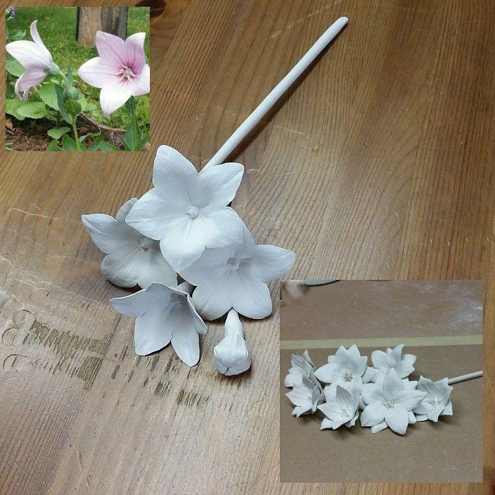 Porcelain flower campanula, porcelain working progress. Making ceramic flowers