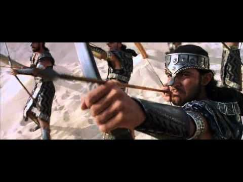 Troy-Achilles- beach battle scene. guys come up from the ocean some come up with horses and they fight on the beach. Duh