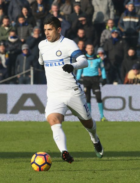 Ever Banega Photos Photos - Lucas Biglia of SS Lazio compete for the ball with Ever Banega FC Inernazionale during the TIM Cup match between FC Internazionale and SS Lazio at Stadio Giuseppe Meazza on January 31, 2017 in Milan, Italy. - FC Internazionale v SS Lazio - TIM Cup