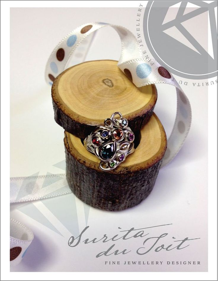 9K white gold engagement ring set with various natural gemstones. Manufactured by Surita du Toit.