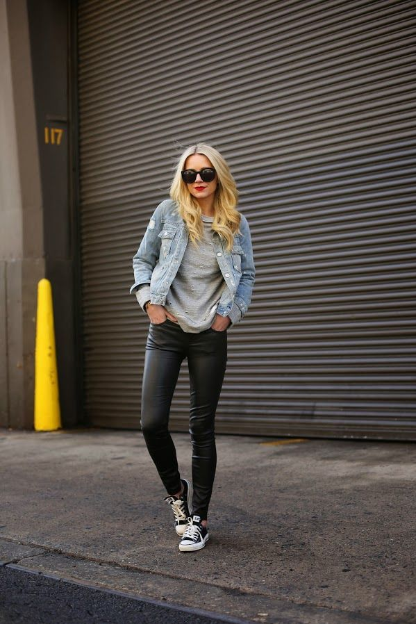 Wear a light blue denim jacket and black leather leggings to create a great weekend-ready look. A cool pair of black and white low top sneakers is an easy way to upgrade your look.  Shop this look for $67:  http://lookastic.com/women/looks/low-top-sneakers-leggings-crew-neck-sweater-denim-jacket-sunglasses/5980  — Black and White Low Top Sneakers  — Black Leather Leggings  — Grey Crew-neck Sweater  — Light Blue Denim Jacket  — Black Sunglasses