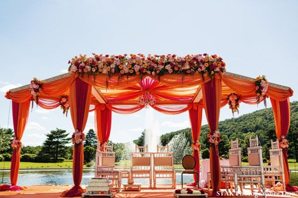 A gorgeous orange mandap for an outdoor wedding.