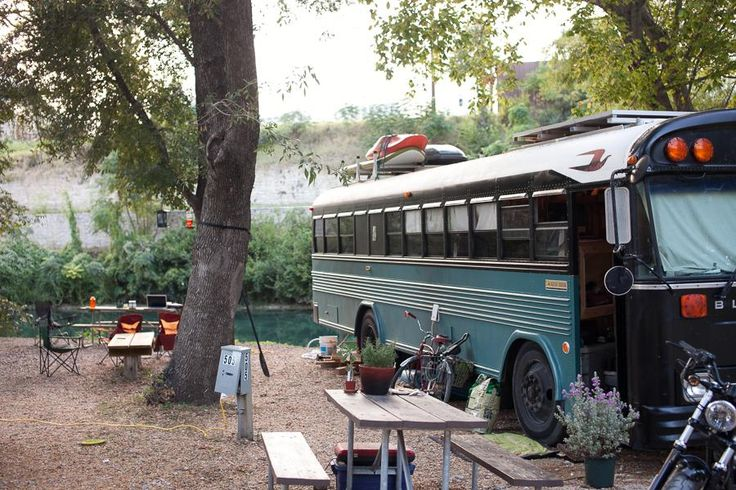 A converted Bluebird bus with off-grid systems and setup for full-time living