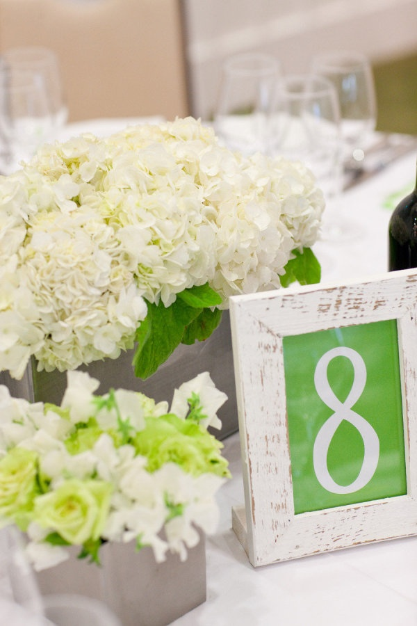 Distressed white frame table numbers. Photography by larissacleveland.com,