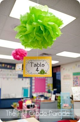 SUPER adorable classroom. My favorite part is the hanging table numbers.