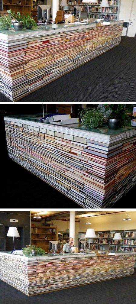 stacks of books create this home office desk and workspace