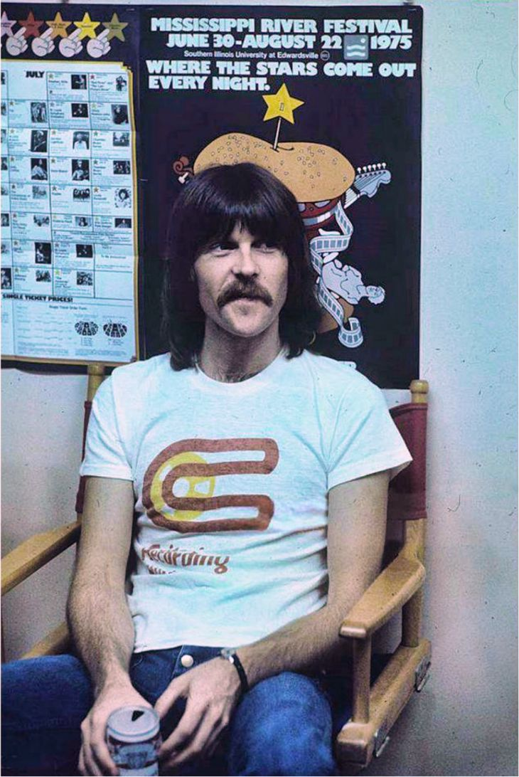 """On this day, July 29, 1975, Randy Meisner was ready to play at the Mississippi River Festival in Edwardsville, Illinois.  The 4 original members of """"Eagles"""" did not disappoint the 2nd largest crowd ever at the Festival in 1975 (Timothy B. Schmit & Joe Walsh join later). They opened the show with """"Take It Easy"""". Fearful of ticket overpricing, the band had in their contract that the festival could NOT charge over $6.50 per ticket. Tickets were $3, $4 and $5. The paid attendance is 29,491."""