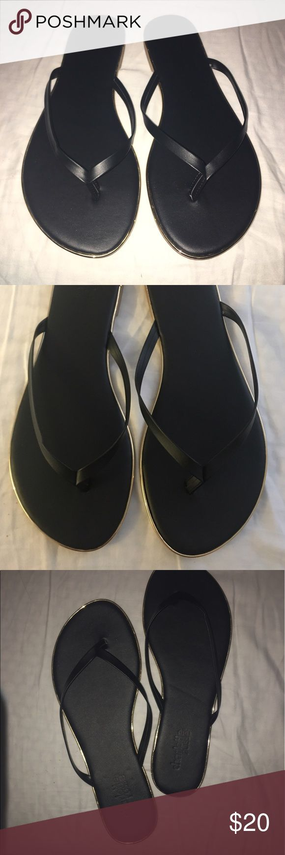 Classic Black Flip Flop Sandals Brand new with tags - Perfect classic sandals will go with everything in your closet!! Can be worn both casual and dressy. Has a gold trim all around back of sandal. This is a perfect flip flop you will wear over and over again. Charlotte Russe Shoes Sandals