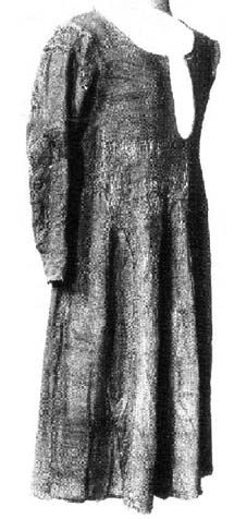 The is probably the best preserved garment amongst the finds from the late 14th century Herjolfsnes. It likely belonged to a woman about 30-40 of age, 150 cm tall.  Triangular gores were inserted into the front and back pieces. The sidegores were made from 1 piece of fabric that has been extended down to the armpit with additional pieces, and divided in the middle by a false seam.  Short sleeves had one inserted gore on the base in the back.
