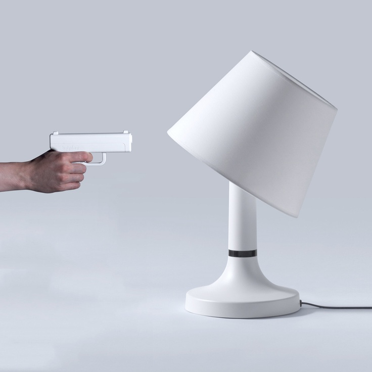 Remote lamp that you shoot to turn off. Might be the coolest thing ever! When you shoot it the lampshade gets knocked to the side and the light goes out. Awesome.