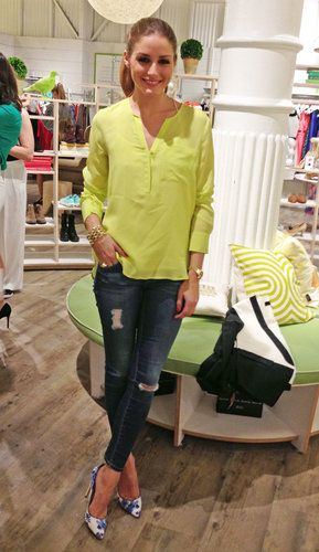 Neon yellow shirt over blue ripped skinny jeans and white - blue floral shoes Olivia Palermo