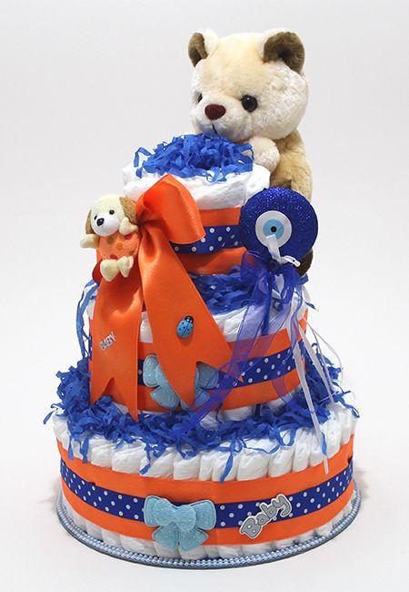 http://www.bebekbezipasta.com/3-katli-bez-pasta/gece-mavisi-bez-pasta  GECE MAVİSİ BEZ PASTA ; 3 kattan oluşan bu modelimiz, 60 adet (Prima Premium Care) ultra korumalı bebek bezi, Saten Kurdela, İthal 25cm Peluş oyuncak ve dekoratif aksesuarlarla hijyenik koşullarda hazırlanmış olup streilizasyonu yapıldıktan sonra şeffaf jelatin ve renkli tül ile kaplanmıştır. Tebrik kartınız ile beraber ilgiliye teslim edilmektedir.