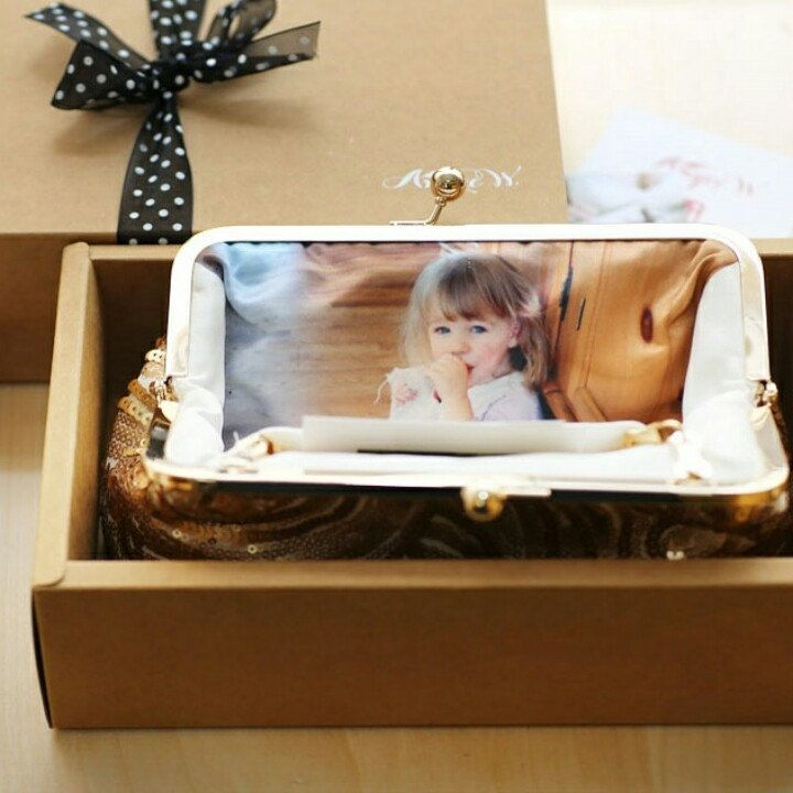 A lovely photo clutch gift going out to a mother of the bride from a bride on the big day.  We love the charm of childhoodphotos and we have a feeling that this is going to evoke somehappy tears...