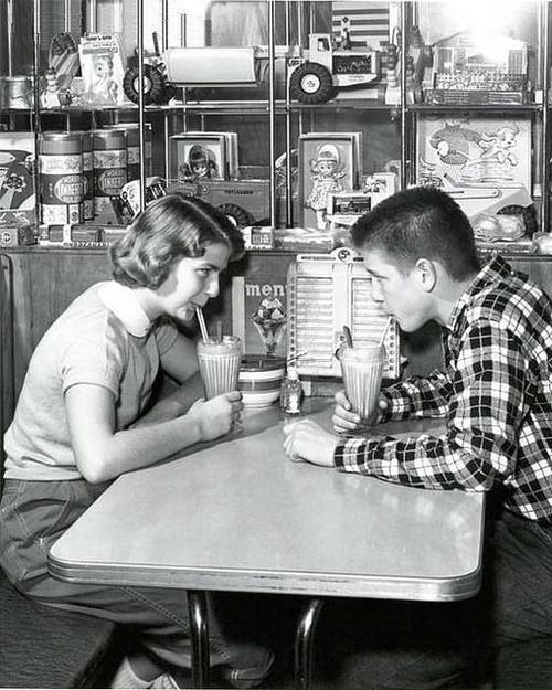 Photo Of Two 1950s Teenagers Drinking Milk Shakes.