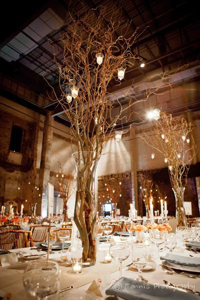 Branches and candle lanterns table centerpiece