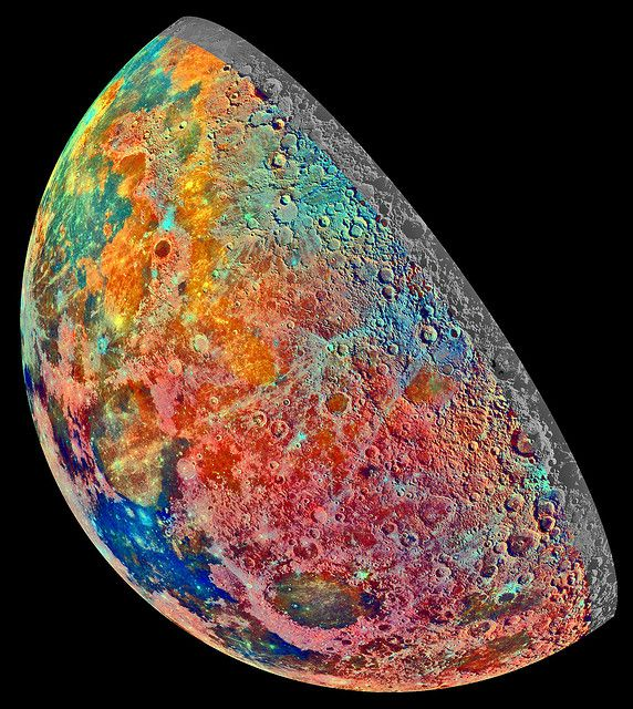 Released to Public: The Mineral Moon (NASA/JPL) This mosaic of 53 images was recorded by the Jupiter-bound Galileo spacecraft as it passed near our own large natural satellite in 1992. The pictures were recorded through three spectral filters and combined in an exaggerated false-color scheme to explore the composition of the lunar surface as changes in mineral content produce subtle color differences in reflected light.