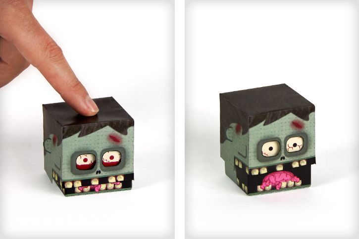 Free printable zombie paper toy. Press his head to change his expression.