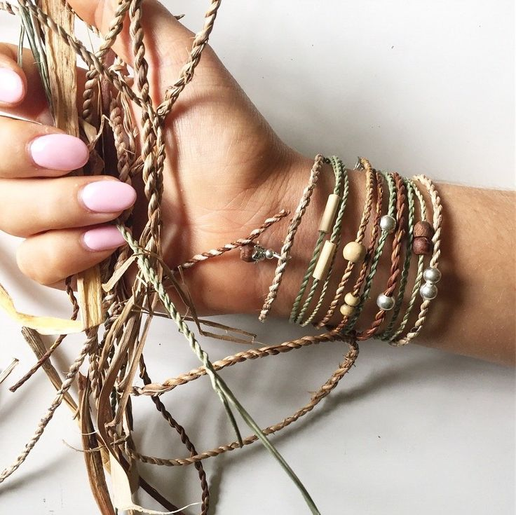Bracelets made by hand from grasses, plants and leaves. The grasses are collected and dried then twisted to form a cord. Each bracelet is a little different from the next making them unique. Some  are embellished with beads and knots. All bracelets are made in Australia.