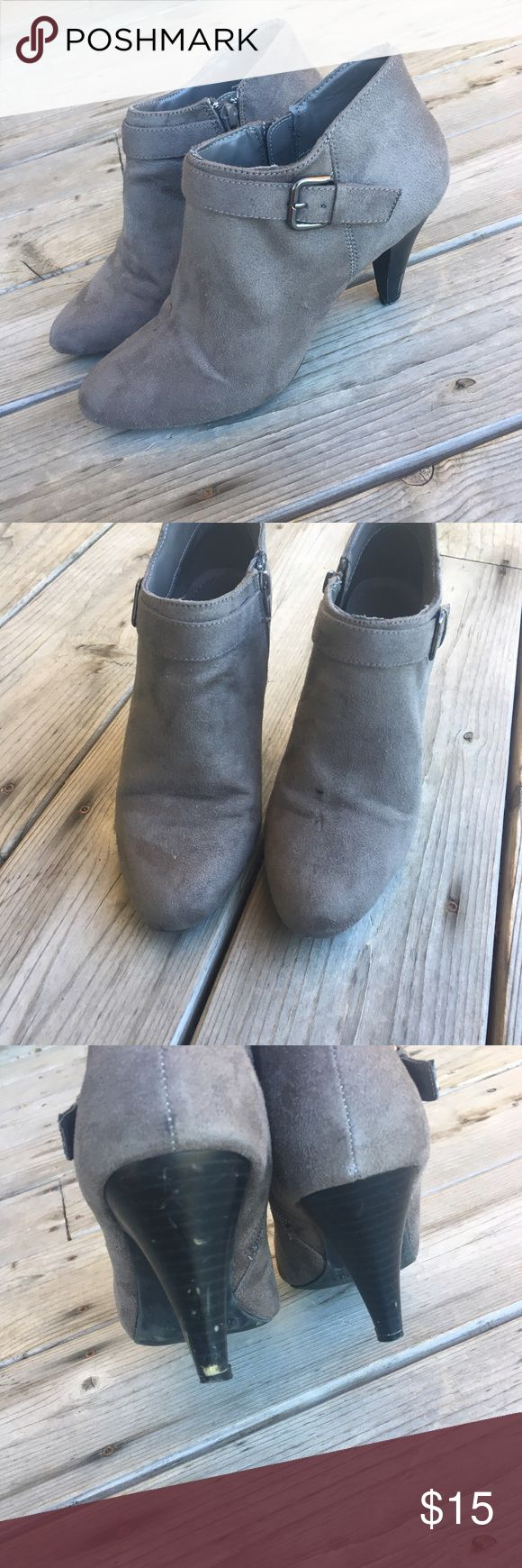 Grey Booties Grey faux suede booties. Silver buckle detail. Heeled. Worn once. Minor flaw on back of heel, easy fix & tiny spot on front pictured. Otherwise like new! Brand is Fioni. • No Trades • Price is firm unless bundled • 15% off of bundles of 3 or more • White House Black Market Shoes Ankle Boots & Booties