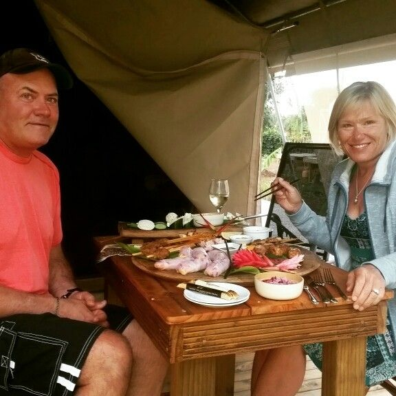 Craig and Heather enjoying a romantic dinner platter delivered to their tent
