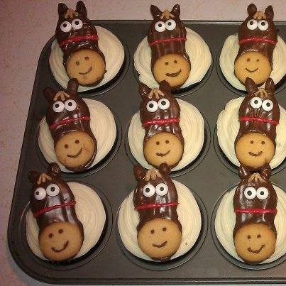 Horse cupcakes.  Nutter Butter cookies dipped in chocolate, Nilla waffer for the nose, edibale wilton eyes, chocolate covered raisins redipped in chocolate for ears, & melted chocolate for accents.