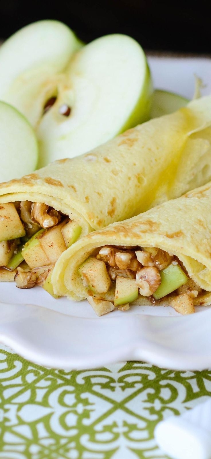 Better than apple pie for breakfast these Apple Pecan Crepes take tart granny smith apples sautéed in brown sugar and wrap them up in a delicate golden crepe for a sweet and zippy way to greet the morning.