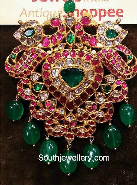 22 carat gold peacock pendant studded with rubies, emeralds and polki diamonds by Jewels India Antique Shoppee.  gold pendant models, latest indian jewellery designs