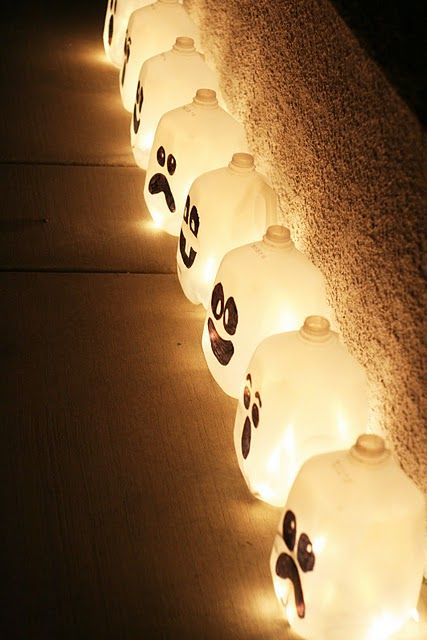milk jugs with a string light and a sharpie. I LOVE halloween! Cheap & cute way to decorate.