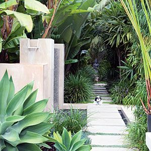 An artful walkway Geometric steppingstones crossing a small pool give the illusion of walking on water. A piece of art tucked amid greenery at the end of the path treats visitors to a visual surprise