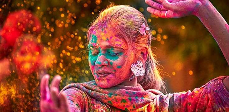 """HOLI Where: India  When: Early spring  The Hindu festival, known as the """"Festival of Colors,"""" celebrates the victory of good over evil with a free-for-all of rainbow splatter—participants cover each other with brightly pigmented powders as they sing and dance through the open streets."""