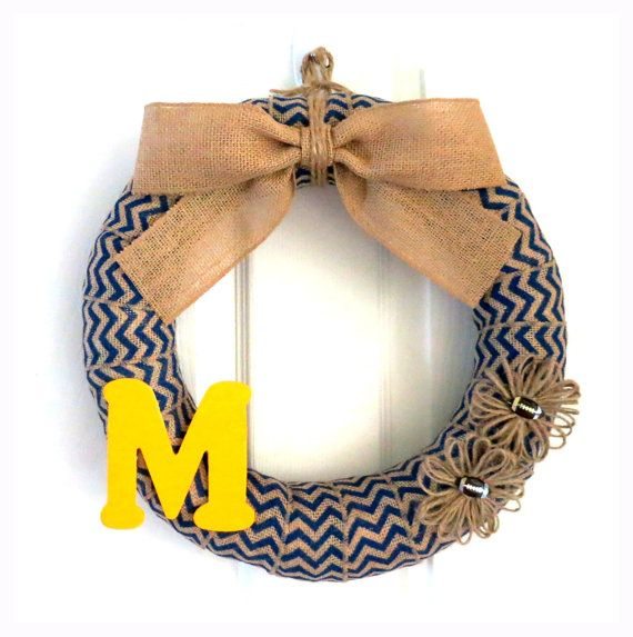 "U of M Wreath  14-Inch University of Michigan Blue Chevron Wreath with ""M"" and Football Jute Flowers by WeddingsAndWreaths on Etsy. Stop by our shop to see our entire selection of collegiate wreaths, everyday wreaths and seasonal wreaths."