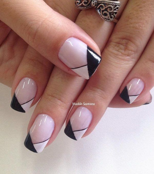 Wonderful looking black and white French tip. Partner this classic French tip with a light blush color as the base. Source