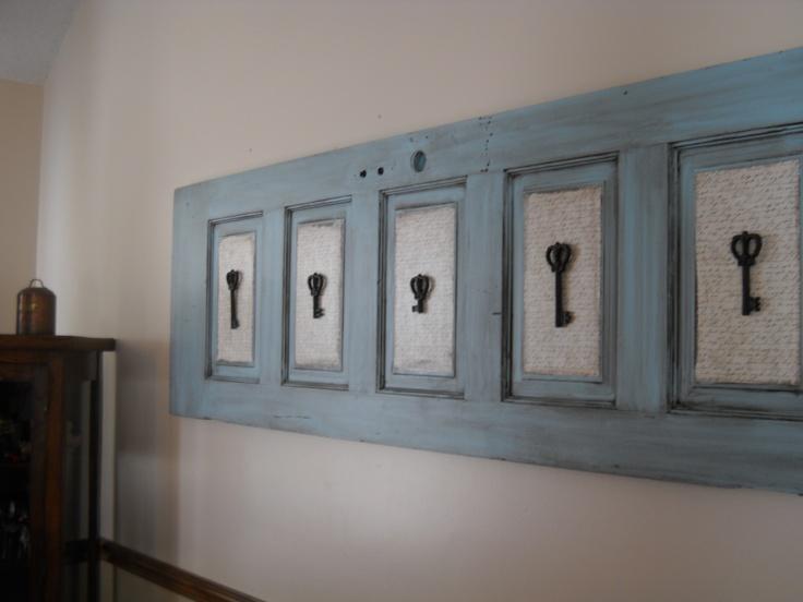 Old Barn door re-purposed. Scrap book paper, iron keys, and custom chalk paint. http://www.facebook.com/2ndEssence